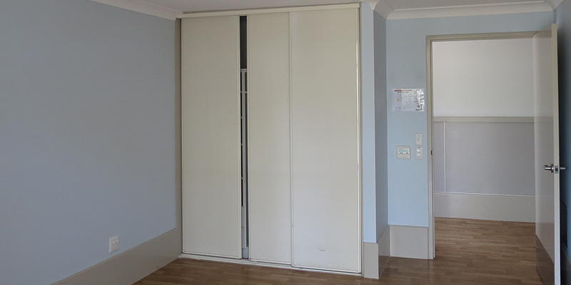 Bedroom with built in wardrobe