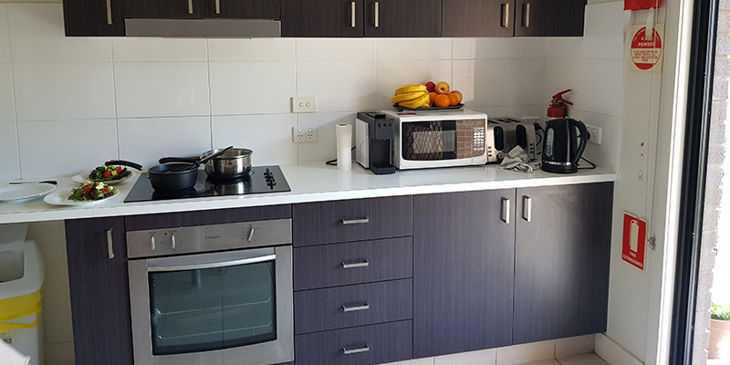 Kitchen cabinets with oven and small appliances