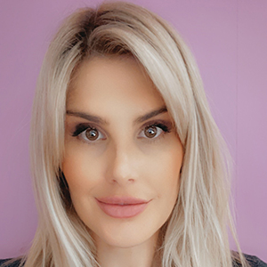 Close up photo of Karen's face. She has long blonde hair.