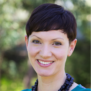 Headshot of Sophia Sambone. She has short dark hair and is wearing a thick beaded necklace and green blouse.