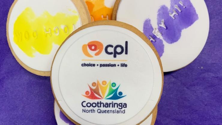Cookies with the CPL and Cootharinga North Queensland logos on a purple background