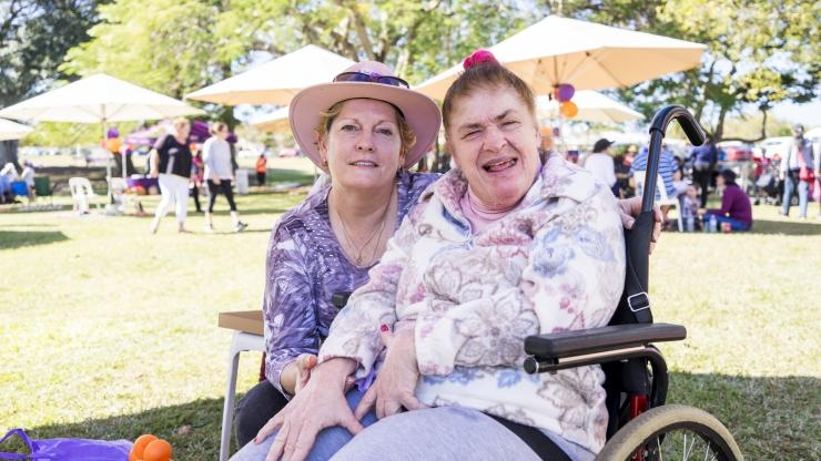 Joan and a support worker at a CPL picnic