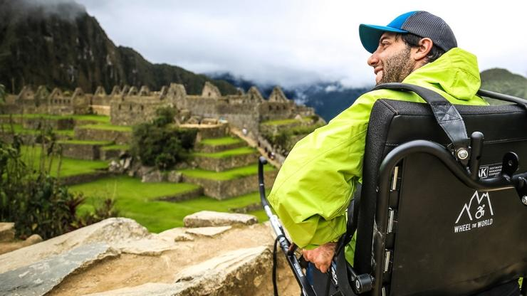 Man in wheelchair looking out at Machu Piccu